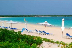 Anguilla beach with beach chairs and umbrellas