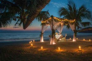 Romantic honeymoon candlelight dinner on the beach